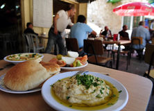 Acre Akko Israel. ACRE, ISR - MAY 13:People eats hummus in Acre on May 13 2009.Hummus is one of the most popular food products to emerge from the Mediterranean Royalty Free Stock Photos