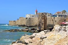 The Acre cityscape with the St John church, Israel. View of the fortress walls and St John`s church, old city of Acre, Israel royalty free stock images