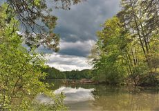 Storm Clouds over Fairy Stone Lake in Virginia. The 168-acre Fairy Stone Lake is great for family fishing and boating and is located in Fairy Stone State Park in royalty free stock photo