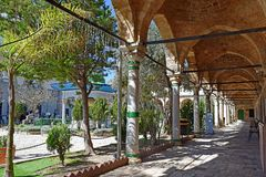 Al Jazzar Mosque in the old city of Acre, Israel. ACRE, ISRAEL - April 11, 2019: courtyard in the Jezzar Pasha Mosque, also known as the White Mosque in Acre royalty free stock photo