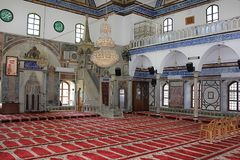Al Jazzar Mosque in the old city of Acre, Israel. ACRE, ISRAEL - April 11, 2019: interior of the Jezzar Pasha Mosque, also known as the White Mosque in Acre stock photography