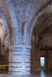Massive pillars supporting the ceiling in the dining room in the ruins of the fortress in the old city of Acre in Israel Royalty Free Stock Photo