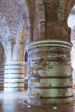 Massive pillars supporting the ceiling in the dining room in the ruins of the fortress in the old city of Acre in Israel Royalty Free Stock Photography