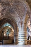 Massive pillars supporting the ceiling in the dining room in the ruins of the fortress in the old city of Acre in Israel royalty free stock images