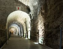 Underground tunnel built by the Knights Templar, passing under the fortress in the old city of Acre in Israel. Acre, Israel, November 03, 2017 : Underground Stock Photos