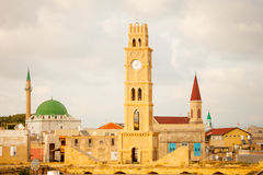 Acre Rooftop View. Rooftop view of the old city of Acre at sunset, with the clock tower, minarets of Sinan Basha Mosque and Al-Jazzar mosque, and other monuments Stock Photography
