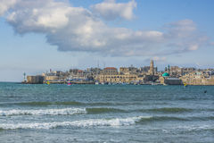 Acre south city walls. View on Acre south city walls and marina over the Mediterranean sea with scenery of mosque towers and colored domes to the horizon Royalty Free Stock Image