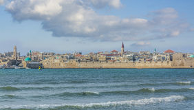 Acre south city walls. View on Acre south city walls over the Mediterranean sea with scenery of mosque towers and colored domes to the horizon Royalty Free Stock Photo