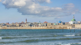 Acre south city walls. View on Acre south city walls over the Mediterranean sea with scenery of mosque towers and colored domes to the horizon Royalty Free Stock Image
