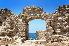 The Acre surrounding wall gate. With small view of the mediterranean sea water stock photo