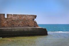 Acremuur en zeehaven Stock Afbeelding
