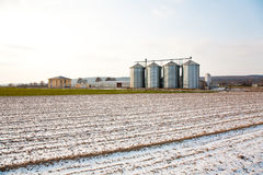 Acres with snow in winter with silo in beautiful light and struc Stock Images