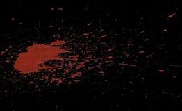 Acrilic paint red splatters. Artificial bloodsplatters on black background stock photo