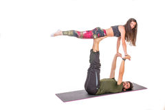 practicing acro yoga exercises in group / bird pose stock