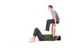 Acro-Yogabewegungen Lizenzfreie Stockfotografie