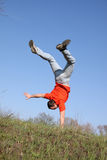Acrobat. With red t-shirt on grass royalty free stock images