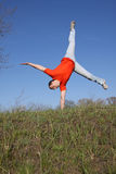 Acrobat. In red t-shirt on grass Stock Photography