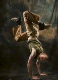Acrobat. Photo of man doing acrobat movement royalty free stock photos