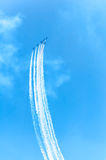 Acrobat Aircraft looping in turbo fly on the sky Royalty Free Stock Image