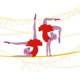 Acrobat ballerinas exercising. Pretty acrobat ballerinas excersize gracefully on a rope Stock Photo