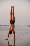Acrobat on the beach Royalty Free Stock Image