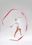 Acrobat. Beautiful gymnast tape in the studio Stock Image