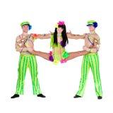 Acrobat carnival dancers doing splits Stock Photo