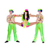 Acrobat carnival dancers doing splits. Against isolated white background Stock Photo