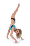 Acrobat Girl. An acrobat girl in practice on a white background stock images