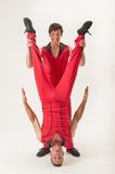 Acrobat holding partner upside down Royalty Free Stock Images