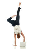 Acrobat with laptop. Concept of overemployment Royalty Free Stock Photo