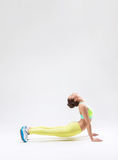 Acrobat. Young girl makes stretching in the studio Royalty Free Stock Photography