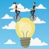Acrobaten in monocycle over een idee Stock Afbeelding