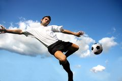 Acrobatic. Young soccer player in acrobatic royalty free stock photo