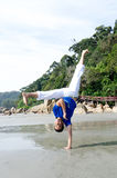 Acrobatic action of capoeira instructor on the beach Stock Photos