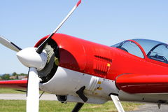Acrobatic aeroplane. Red acrobatic aeroplane front-side view with propeller Stock Image