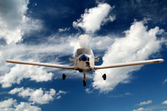 Acrobatic aeroplane Zlin z-142. Small aircraft flying in the sky with clouds Royalty Free Stock Images