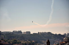 Acrobatic aircraft over the city of Oporto Royalty Free Stock Photos