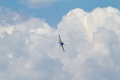 Acrobatic airplane on cloudy sky Stock Images