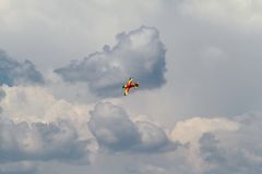 Acrobatic airplane on dark clouds Stock Photo