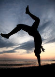 Acrobatic at beach. At sunset Stock Photography