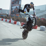 Acrobatic biker at EICMA 2013 in Milan, Italy Stock Photos
