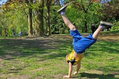 Acrobatic boy in park Stock Photography