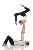 Acrobatic business people doing handstand in pair Royalty Free Stock Photography