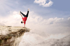Acrobatic competition cartwheel on mountain. A guy is doing cartwheel acrobatic on mountain high Royalty Free Stock Images
