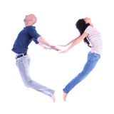 Acrobatic couple forming a heart shape. Acrobatic couple forming a valentine's heart shape with their bodies, isolated over white background, concept of Royalty Free Stock Image
