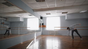 Acrobatic dance at the dance studio. Dancer performs trick in the dance. Falling to his knees in the dance. Light dance stock video footage