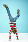 Acrobatic feat. Little boy standing on hands Stock Images