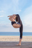 Acrobatic flexible young girl dancer Royalty Free Stock Images