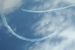 Acrobatic flying team. Drawn a smile in the sky stock images